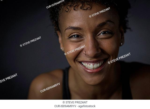 Close up studio portrait of smiling mature woman