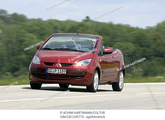 Mitsubishi Colt CZC 1.5, model year 2006-, red, driving, diagonal from the front, frontal view, country road, open top