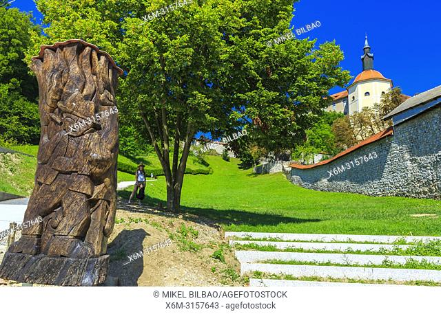 Loka Castle and wooden sculpture. Skofja Loka. Upper Carniola region. Slovenia, Europe
