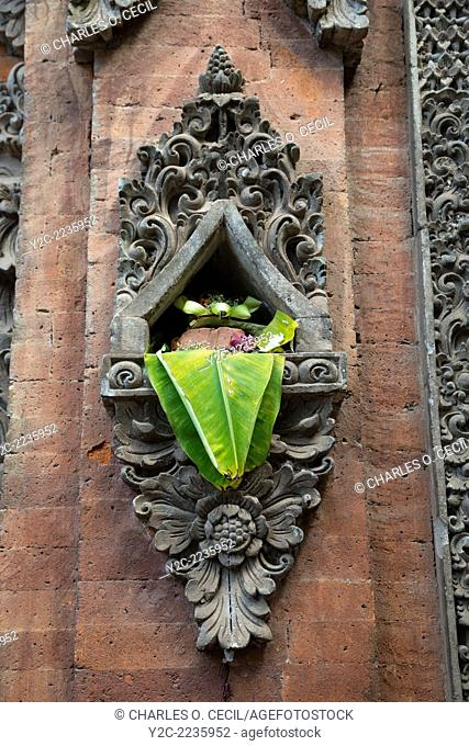 Bali, Indonesia. Canang (Offering) in a Wall-niche adjacent to Entrance to a House. Tenganan Village