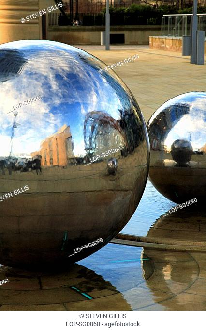 England, South Yorkshire, Sheffield, Reflections of the Winter Garden in polished chromed spheres water feature