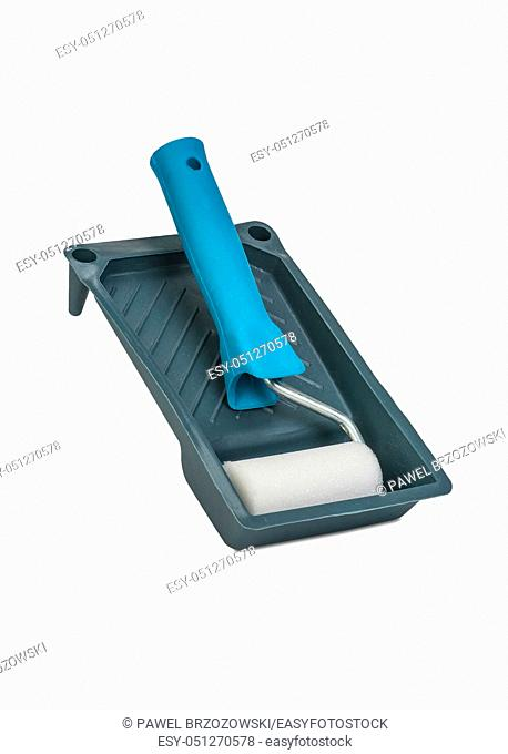 Paint roller and tray isolated on white background