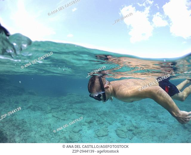 Young man snorkeling in Formentera island Balearics Spain