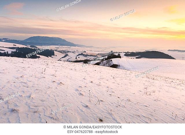 Turiec region and view of Velka Fatra mountain range in winter.