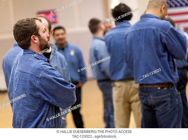 Blue collar supporters at Hillary Clinton's Get Out the Vote event at Chicago Journeyman Plumber's Hall on March 14, 2016 in Chicago, Illinois