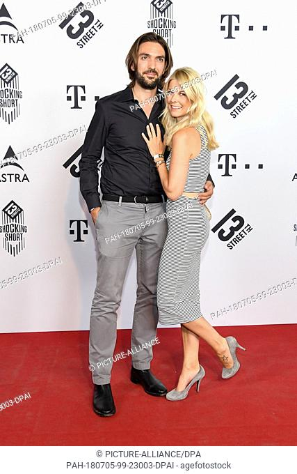 04 July 2018, Munich, Germany: Max Wiedemann, producer and model Tina Kaiser attending the Shocking Short Awards at the Filmfest München