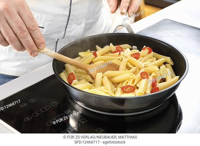 Pre-cooked pasta in pan with chili