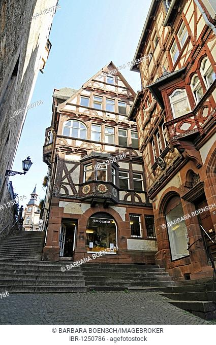 Second hand bookshop, shop for antique books, Steile Strasse street, stairs, historic half-timbered houses, historic centre, Marburg, Hesse, Germany, Europe