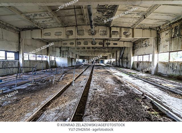 Inside the farm building of old kolkhoz in abandoned Mashevo village of Chernobyl Nuclear Power Plant Zone of Alienation in Ukraine
