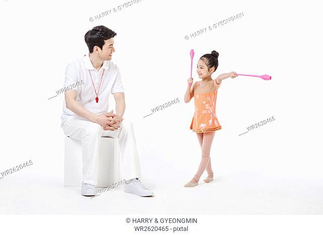Smi coach and rhythmic gymnast with clubs