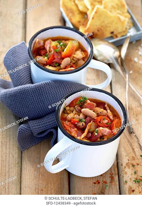 Twp tin mugs with bean soup
