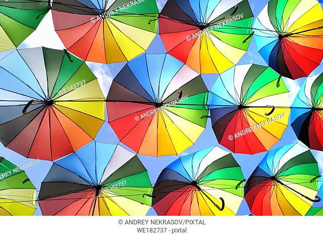 Colorful umbrellas background. Lots of umbrellas coloring the sky in the city of Odessa, Ukraine. Street decoration