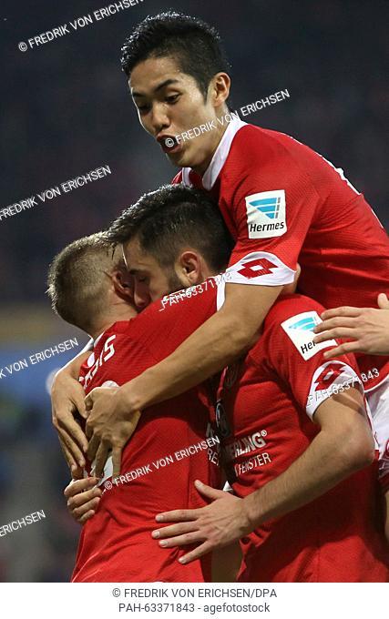 Mainz' Yunus Malli (C) celebrates his 2-0 goal with teammates Pablo de Blasis (L) and Yoshinori Muto (top) during the German Bundesliga soccer match between 1