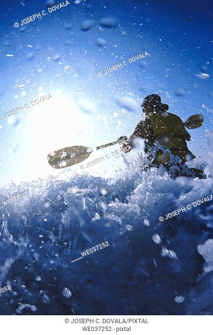 Kayaker in wave splash