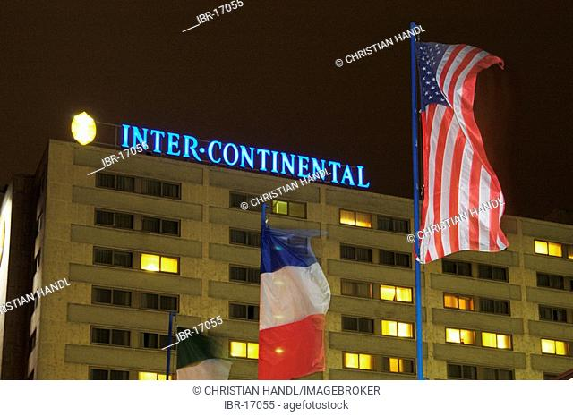 The hotel Intercontinental with flags of USA and France Vienna Austria