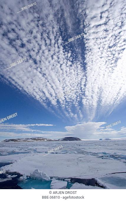 Clouds over and ice in Wahlenbergfjord
