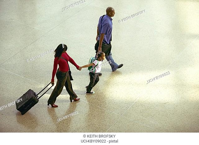African family walking through airport
