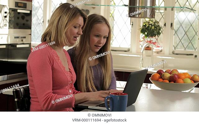 MS Mother and Daughter Using Laptop