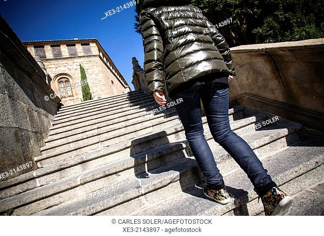 Young girl climbing stairs. Old City. Salamanca, Castile-Leon, Spain
