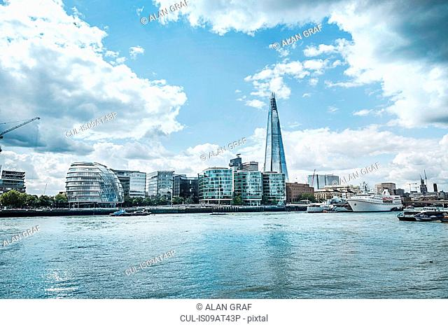 Waterfront cityscape of the Shard and Thames river, London, England, UK