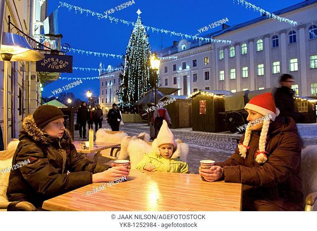 Family Sitting in Street Cafe Suudlevad Tundengid, Christmas, Winter, Tartu, Estonia