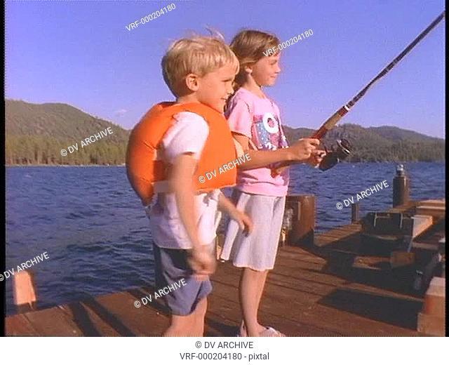 children fish on a pier