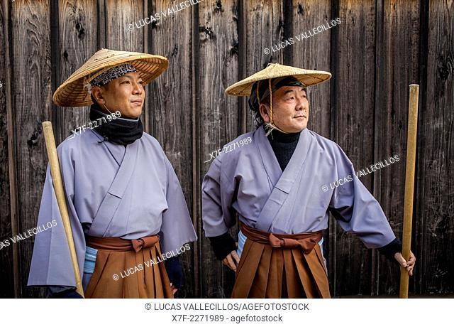 Museum guides in the uniform of a former guardian,Dejima museum,Nagasaki, Japan