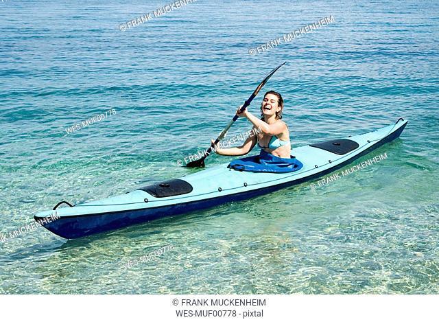 Greece, Ithaca, Woman kayaking