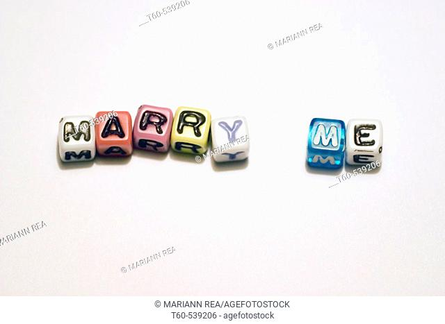 Letters spelling out Marry me on a white background