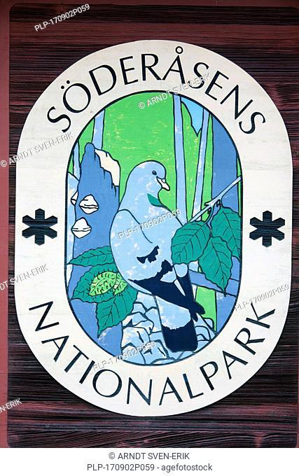 Sign with logo of the Soederasen NP / Söderåsen National Park in autumn, Skane / Scania, Sweden