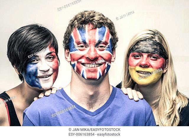 Portrait of happy young people with painted European flags on their faces