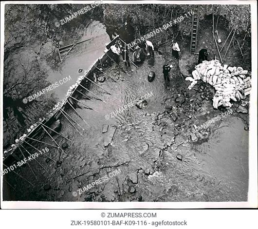 Jan. 01, 1958 - Firemen and police dam a river in search for missing girl in Lanrkshire. Firemen and police built a dam in the River Clader near Calder Park Zoo