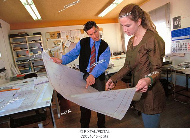 Architects looking arquitectural plans