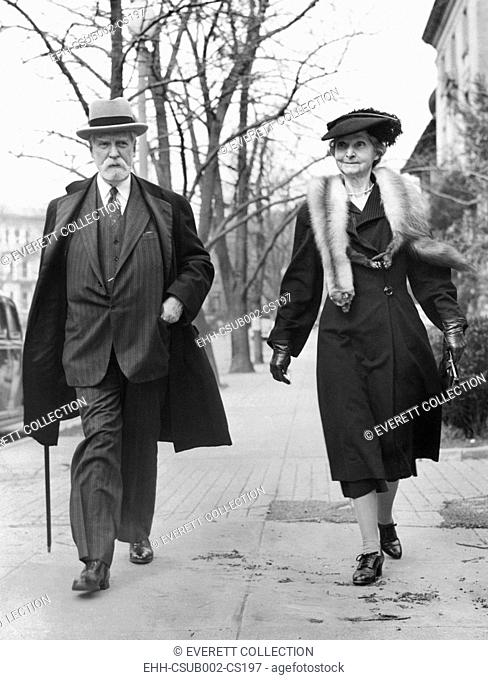 Former Chief Justice Charles Evans Hughes and Antoinette Carter Hughes walk in Washington. Hughes was celebrating his 82nd birthday on April 11, 1944