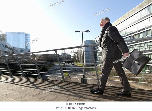 Senior businessman with briefcase on the move