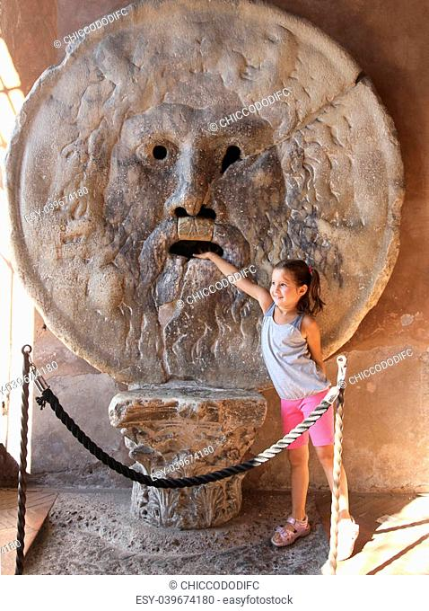 nice young girl puts her hand inside the Bocca della Verit?, Rome