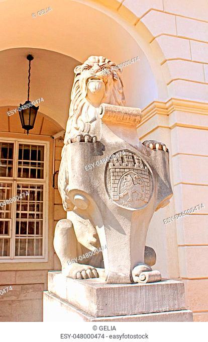 Symbol, emblem of the city Lviv, Ukraine. Marble sculpture - a lion near the town hall in Lviv city, Ukraine