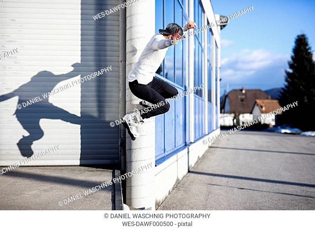 Young man doing a trick on inline skates