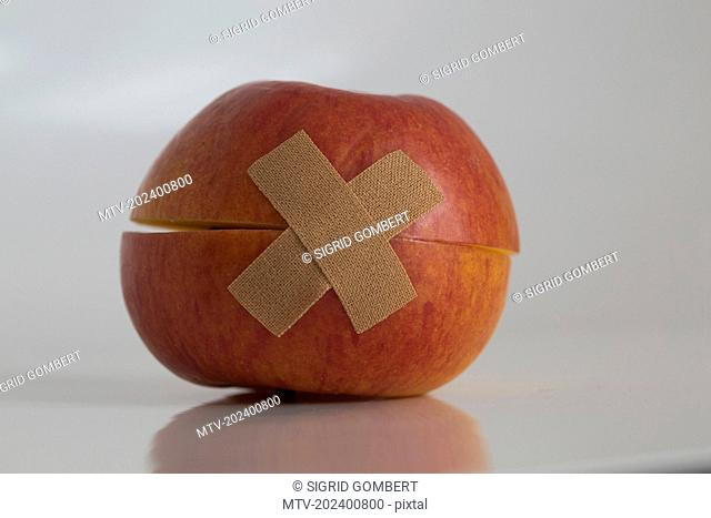 Close-up of apple with band aid