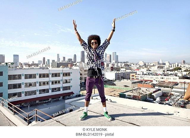 African American man and cityscape from urban rooftop