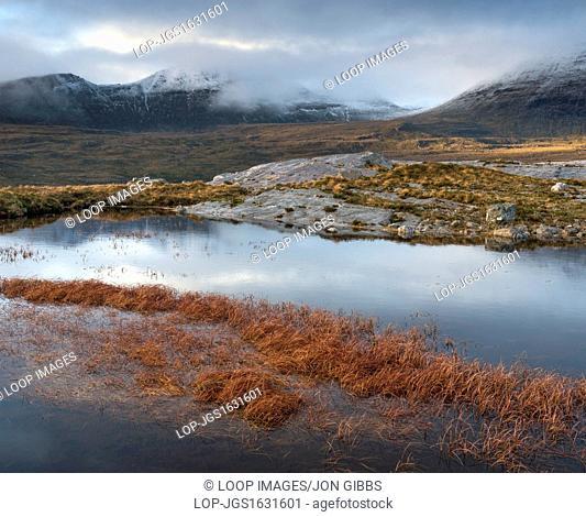 The mountain Quinag viewed across a lochan near Inchnadamph