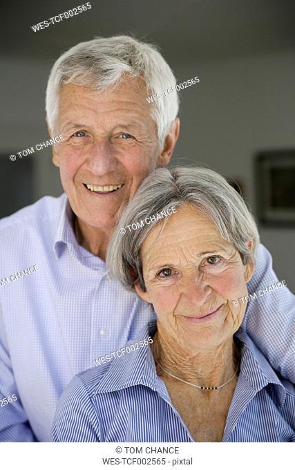 Germany, Bavaria, Senior couple smiling, portrait