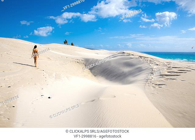Woman walking on sand dunes, Is Arenas Biancas, Teulada, province of Cagliari, Sardinia, Italy