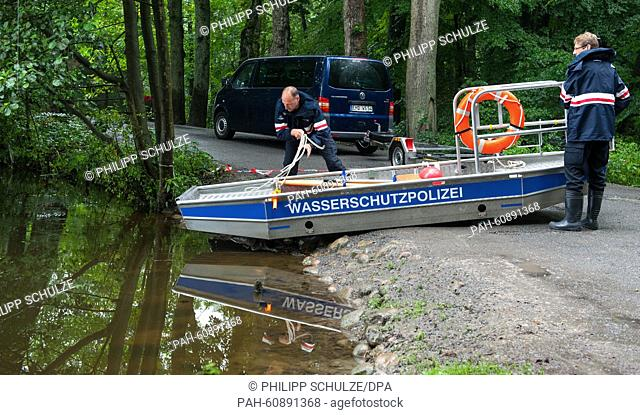 Police forces prepare a boat with a sonar device during the search for a missing mother and her daughter in Buchholz in der Nordheide, Germany, 19 August 2015