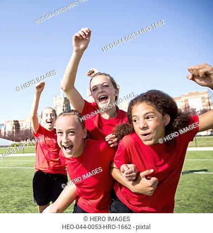 Girls soccer team cheering on field