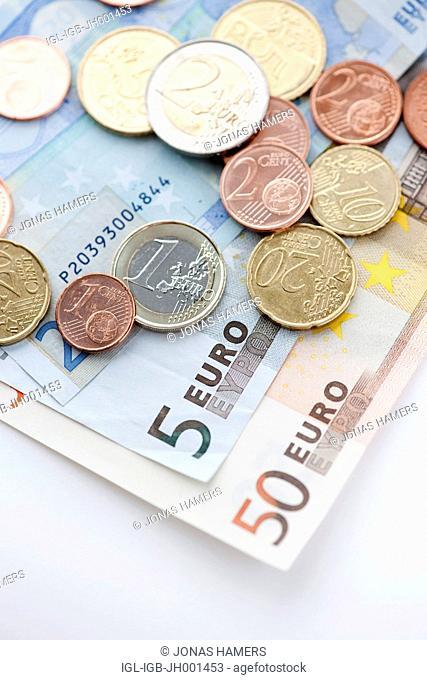 Various Euro banknotes and Euro coins
