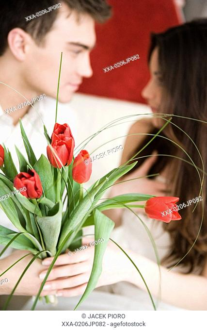 portrait of couple with red tulips