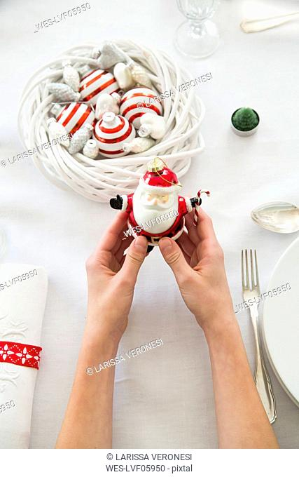 Hands holding Santa figurine