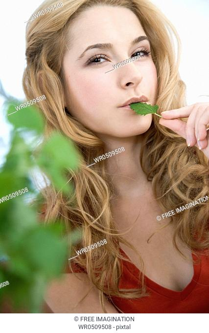 young woman with mint leaf