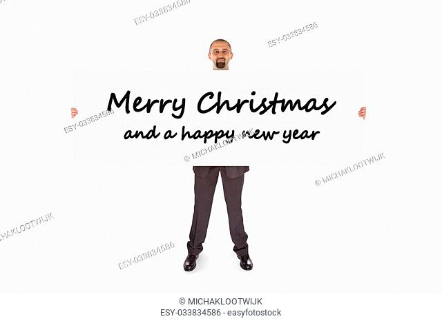 Smiling businessman holding a really big card, isolated on white, merry christmas and a happy new year